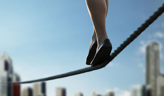 Choosing Sides: Content Marketing Quality vs. Quantity image tight rope walker.jpg
