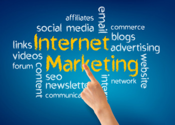 Hand pointing at a Internet Marketing illustration on blue background.
