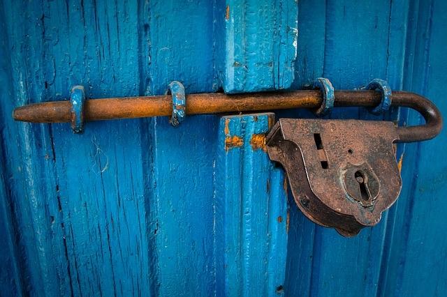 door with old key locking the door