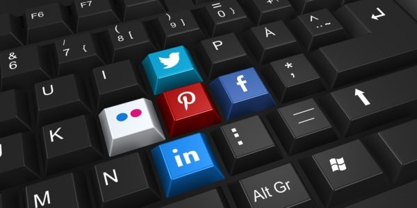 keyboard with social media icons - twitter, pinterest, facebook, and linkedin